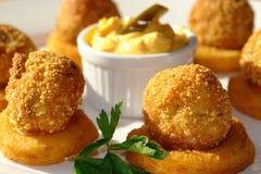 Cheese balls witn onion rings Stock Photos