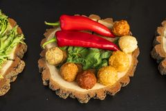 Cheese balls on a wooden bread Royalty Free Stock Images