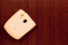 Cheese on a bamboo mat Stock Photography