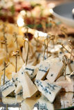 Cheese on a banquet table Royalty Free Stock Images