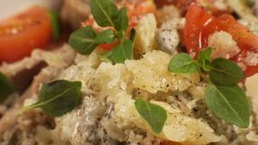 Cheese, basil leaves and cherry on pasta top view. Video. Horizontal stock video footage