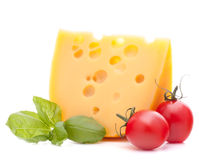 Cheese and basil leaves still life Stock Photos