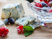 Cheese with berries stock photo
