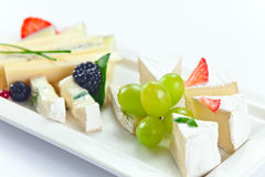Cheese with berries Royalty Free Stock Photos