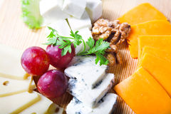 Cheese and berry Stock Photography