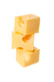 Cheese with big holes form a cube is on each other Royalty Free Stock Photography