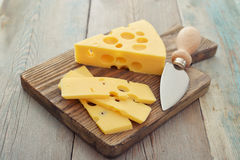 Cheese with big holes Stock Images