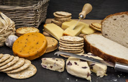 Cheese and biscuits and fresh bread. A selection of cheeses and bread royalty free stock photo
