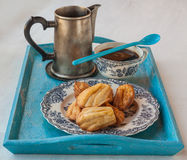 Cheese biscuits, madeleines and coffee with a cup of coffee Royalty Free Stock Images