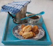 Cheese biscuits, madeleines and coffee with a cup of coffee Royalty Free Stock Photo