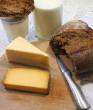 Cheese and black bread Stock Image