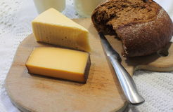 Cheese and black bread Royalty Free Stock Image