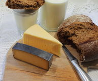 Cheese and black bread Stock Images