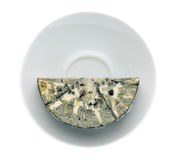 Cheese with black mold on the plate. View from above. Stock Photos