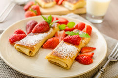 Cheese Blintzes. Filled pancakes riccota and creame fresh with fresh fruit and mint Royalty Free Stock Photography