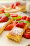 Cheese Blintzes. Filled pancakes riccota and creame fresh with fresh fruit and mint Royalty Free Stock Images