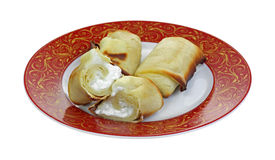 Cheese Blintzes Single Halved. A nice view of whole and halved cheese blintzes on plate Stock Photo