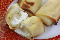 Cheese Blintzes Single Halved up Close. A great close view of a halved  and whole cheese blintzes Stock Photography