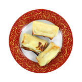 Cheese Blintzes Top View. Looking down at three cheese blintzes on plate Royalty Free Stock Photo