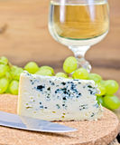 Cheese blue on board with wine and grapes Stock Image