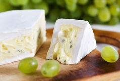 Cheese with blue mould and grape Stock Photos