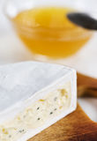 Cheese with blue mould and honey Royalty Free Stock Images