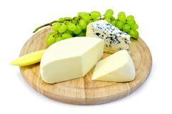 Cheese blue and suluguni on round board Royalty Free Stock Image