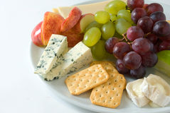 Cheese board. A variety of chees served with fresh fruit Stock Image