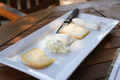 Cheese board with 5 cheeses. A beautiful cheese board with soft lighting Royalty Free Stock Photography