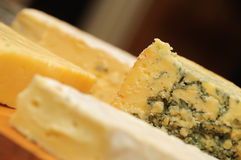 Cheese Board. Image of Cheese board taken at low angle showing stilton brie and other cheeses Royalty Free Stock Photo