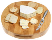 Cheese  Board & Biscuits Isolated. Cambozola blue cheese with selection of biscuits and crackers Stock Photos