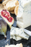 Cheese. Board with blue , crackers and figs royalty free stock image