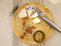 Cheese board. Cheeseboard. Camembert, chutneys from pears and oranges, almonds Stock Photo