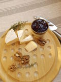 Cheese board. Cheeseboard. Camembert, walnuts and blackcurrant chutney Royalty Free Stock Images