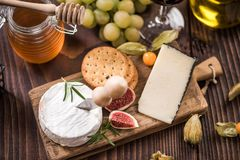 Cheese board with crackers,fig and grapes Royalty Free Stock Photo