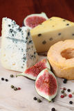 Cheese board with figs Stock Photos