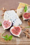 Cheese board with figs and nuts Stock Image