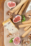 Cheese board with figs and nuts Stock Photography