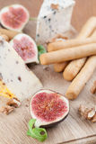 Cheese board with figs and nuts Royalty Free Stock Photos