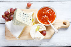 Cheese board with grapes and jam Stock Images