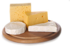 Cheese on a board isolated Stock Photography