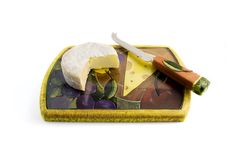 Cheese on a board with knife Royalty Free Stock Photography