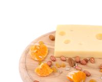 Cheese on board with nuts and orange. Stock Photography