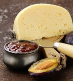 Cheese board plate with plums jam Stock Photography