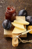 Cheese board plate with plums jam Royalty Free Stock Image