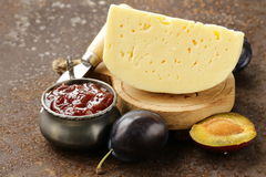Cheese board plate with plums jam Stock Photos