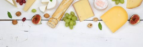 Cheese board platter plate Swiss bread Camembert copyspace banne. R top view above Stock Image