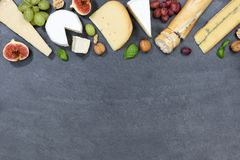 Cheese board platter plate Swiss bread Camembert copyspace slate. Top view from above Royalty Free Stock Images