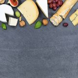 Cheese board platter plate Swiss bread Camembert copyspace squar. E slate top view from above Royalty Free Stock Photography