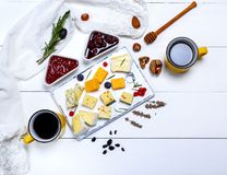 Cheese board with raspberry and strawberry jam Stock Photography